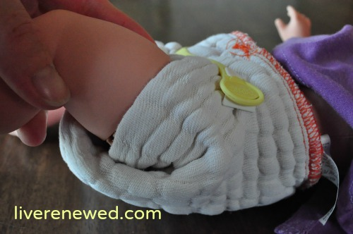 how to put a prefold cloth diaper on a baby