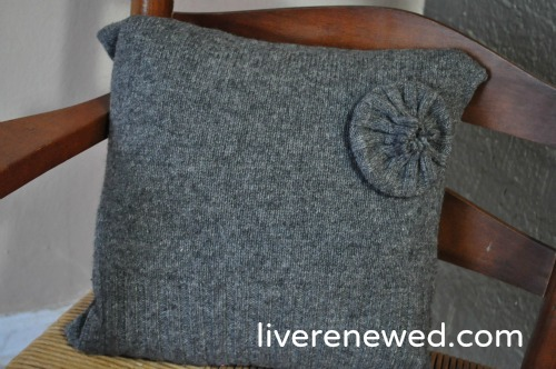 embellished upcycled sweater pillow