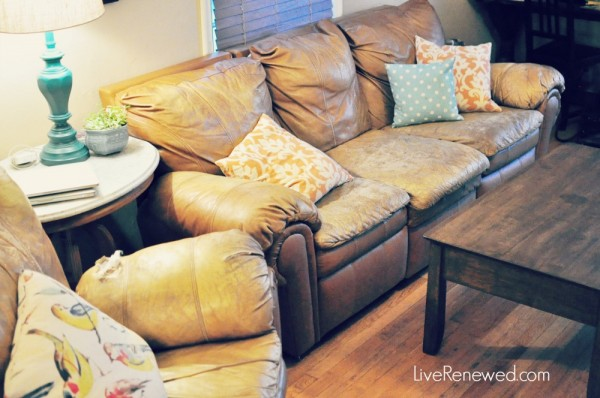 Our seen-better-days couch made a little more beautiful with throw pillows I love at LiveRenewed.com